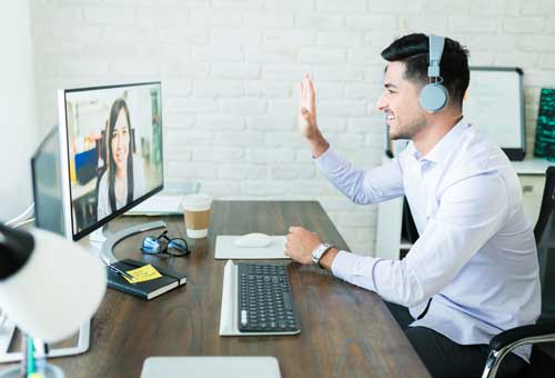 Professionals Greeting Through Conference Call